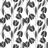 Abstract seamless retro pattern with silhouettes of tulips . Floral design Royalty Free Stock Image