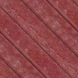 Seamless photo pattern of red wooden planks. Abstract seamless texture for designers with red panels. Surface with cracks and corrosion. Diagonal top face stock image