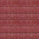Seamless photo pattern of red wooden planks. Abstract seamless texture for designers with red panels. Surface with cracks and corrosion. Horizontal top face royalty free stock photography