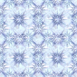 Abstract seamless winter pattern of frozen crystals resembling ice stars. Blue and white background with snowflakes and ice stars Royalty Free Stock Photos