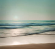 An abstract seascape with blurred panning motion on paper backgr Stock Images