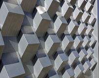 Abstract Section of Extruded Cube Wall. Stylish modern shiny metal extruded metal wall Stock Image