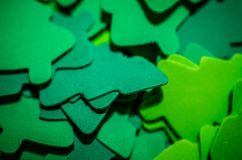 Abstract selective focus of felt paper green Christmas trees, useful for backgrounds. Selective focus. Abstract selective focus of felt paper green Christmas stock photo