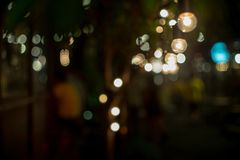 Abstract selective focus objects of vintage lamps with bokeh lights in background royalty free stock photos
