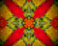 Abstract shape mandala. Small extruded square forming 4 sided star shape in the middle. Red, green, yellow, white Royalty Free Stock Photography