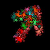 Abstract shape of puzzle on black background. There is a abstract shape of colorful puzzle pieces Stock Image