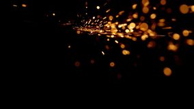 Abstract shape of splashing sparklets falls down.  stock video footage