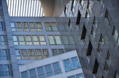 Abstract shapes of modern buildings made of steel and glass Royalty Free Stock Photo
