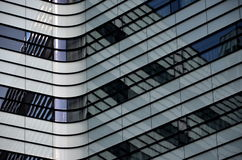 Abstract shapes of modern buildings made of steel and glass Royalty Free Stock Photos