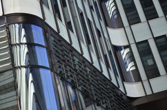Abstract shapes of modern buildings made of steel and glass Royalty Free Stock Image