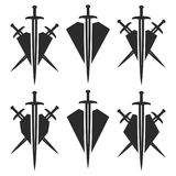 Abstract shield and sword signs. Royalty Free Stock Images