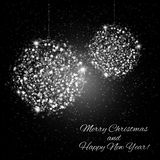 Abstract Shining Christmas balls on black background Royalty Free Stock Photo