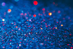 Abstract shining glitters blue makeup background. Blurred multicolored tinsel, selective focus with shallow depth of field. Glisten foil backdrop, christmas Stock Image