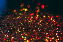 Abstract shining glitters golden holiday backdrop. Abstract shining glitters golden holiday bokeh background with copy space. Defocused lights backdrop Royalty Free Stock Photography