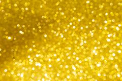 Abstract shiny gold bokeh background Royalty Free Stock Images