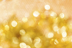 Abstract shiny gold bokeh light background Stock Images