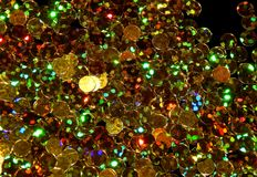 Abstract shiny golden background of Christmas shimmers. Close-up stock image