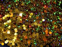 Abstract shiny golden background of Christmas shimmers. Close-up royalty free stock photography