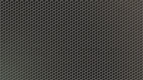 Abstract Shiny Hexagonal Metal Mesh in Dark Background. Abstract seamless hexagonal metal texture in black background for website, banner, business card stock photo