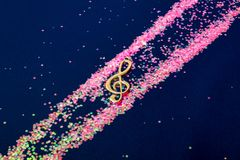 Abstract shiny musical note on blue background. Abstract shiny musical note on blue background Royalty Free Stock Photo