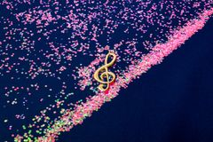 Abstract shiny musical note on blue background. Abstract shiny musical note on blue background Royalty Free Stock Images