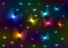 Abstract shone butterflies. Multi-coloured abstract butterflies on a black background Stock Photography