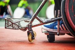 Abstract shot of disabled person. Closeup of the feet on a wheelchair of a disabled person stock photo