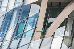 Abstract shot of a facade of a glass building. An abstract photograph composition comprising of a part of the facade of a glass building Stock Image