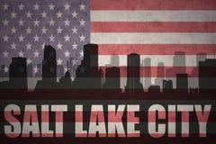Abstract silhouet van de stad met tekst Salt Lake City bij de uitstekende Amerikaanse vlag stock illustratie