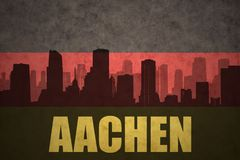Abstract silhouette of the city with text Aachen at the vintage german flag. Background Royalty Free Stock Photography