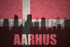 Abstract silhouette of the city with text Aarhus at the vintage danish flag Royalty Free Stock Photography