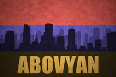 Abstract silhouette of the city with text Abovyan at the vintage armenian flag Stock Photo