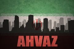 Abstract silhouette of the city with text Ahvaz at the vintage iranian flag. Background Royalty Free Stock Photography