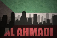 Abstract silhouette of the city with text Al Ahmadi at the vintage kuwait flag. Background vector illustration