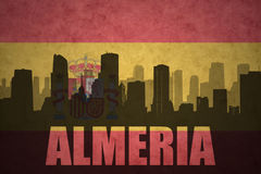 Abstract silhouette of the city with text Almeria at the vintage spanish flag Royalty Free Stock Photos