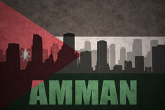 Abstract silhouette of the city with text Amman at the vintage jordan flag. Background Stock Images