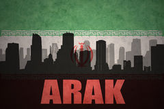 Abstract silhouette of the city with text Arak at the vintage iranian flag. Background Stock Photography