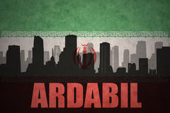 Abstract silhouette of the city with text Ardabil at the vintage iranian flag. Background Stock Image