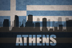 Abstract silhouette of the city with text Athens at the vintage greece flag Stock Photo