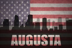 Abstract silhouette of the city with text Augusta at the vintage american flag. Background stock images