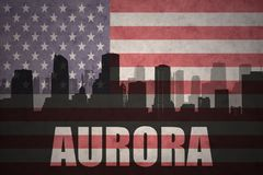Abstract silhouette of the city with text Aurora at the vintage american flag Royalty Free Stock Images