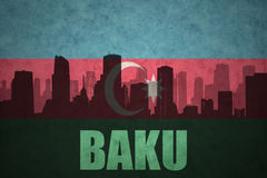 Abstract silhouette of the city with text Baku at the vintage azerbaijan flag Stock Photography