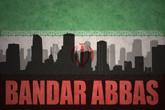 Abstract silhouette of the city with text Bandar Abbas at the vintage iranian flag. Background Stock Photo