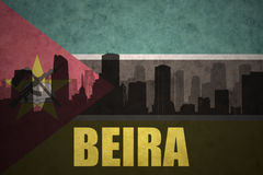 Abstract silhouette of the city with text Beira at the vintage mozambican flag. Background Stock Photo