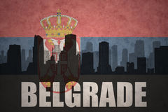 Abstract silhouette of the city with text Belgrade at the vintage serbian flag Stock Images