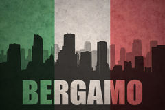 Abstract silhouette of the city with text Bergamo at the vintage italian flag Stock Photo
