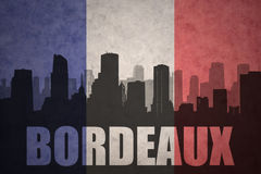 Abstract silhouette of the city with text Bordeaux at the vintage french flag Stock Photos