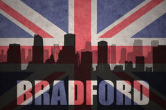 Abstract silhouette of the city with text Bradford at the vintage british flag. Background Stock Photos