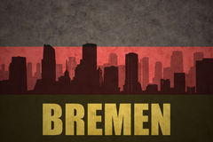 Abstract silhouette of the city with text Bremen at the vintage german flag Stock Images
