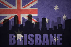 Abstract silhouette of the city with text Brisbane at the vintage australian flag. Background Royalty Free Stock Photography